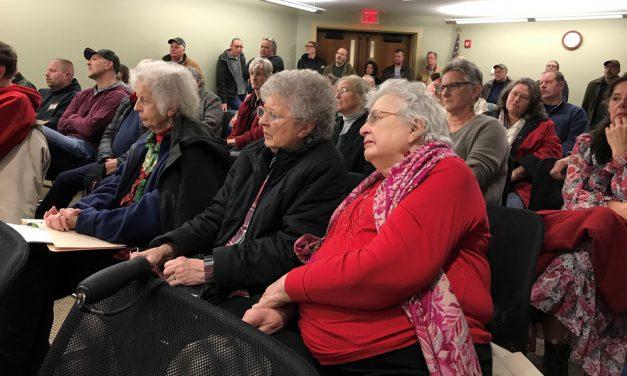 Big crowd listens to Angevine apology