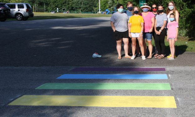 Crosswalk takes on colors of a rainbow