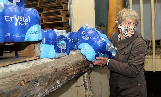 Volunteers deliver water to town schools